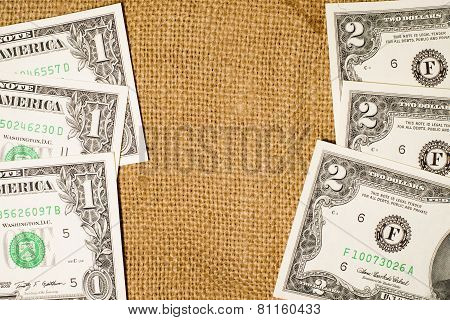 Banknotes Us  $1 And $ 2 Dollars On Sacking