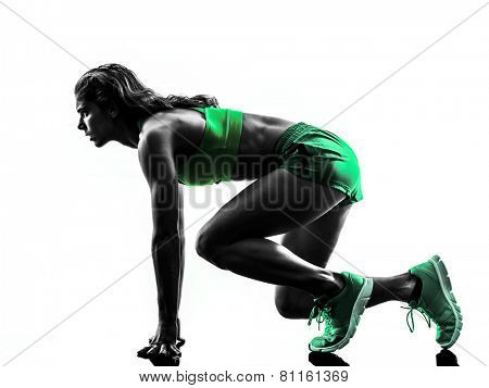 one caucasian woman runner running jogger jogging on starting blocks  in studio silhouette isolated on white background