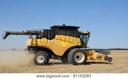 A modern combine harvester in a wheat crop