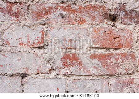 Textured Old Red Wall Of Brick With Traces Of Rubbing