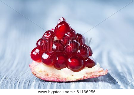 Pomegranate Seeds. Part Of Pomegranate Fruit. Old Gray Wooden Background. Macro View. (soft Focus).