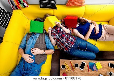 Sleeping and tired students on the couch