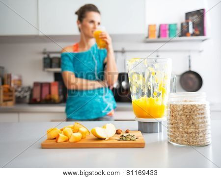 Close-up On Pumpkin Smoothie And Ingredients On Table And Fitness Young Woman In Background