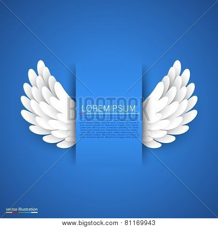 Artificial white paper wings on blue background.