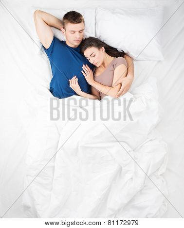 Top view photo of sleeping couple