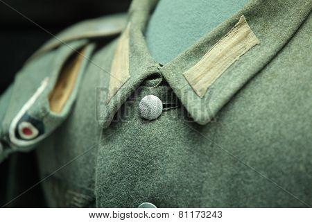 button on a soldier's uniform