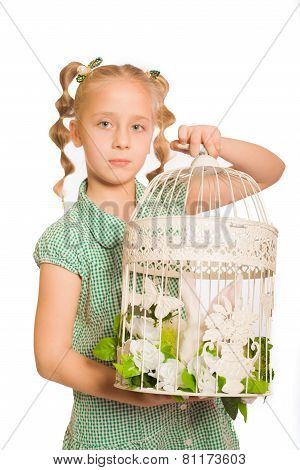 Little girl with a rabbit  in cell