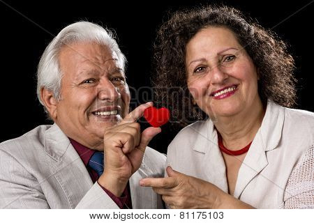 Happy Senior Couple With A Red Valentine Heart