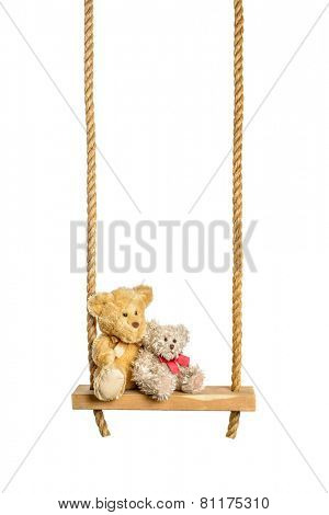 Teddy bears on rope swing isolated on a white background