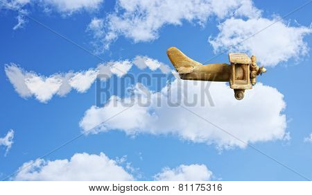 Toy plane in bright blue sky