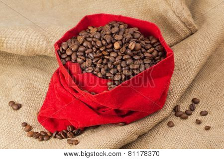 Coffe Beans In Red Velvet Sac