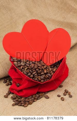 Coffe Beans In Red Velvet Sac Witht Wo Red Hearts