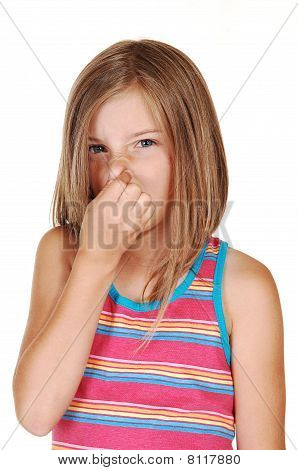 Girl Holds Her Nose Closed.