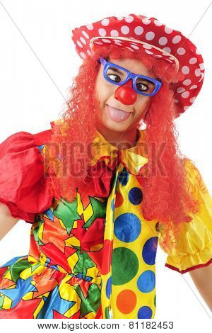 A colorful clown making a goofy cross-eyed, tongue extended face.  On a white background.