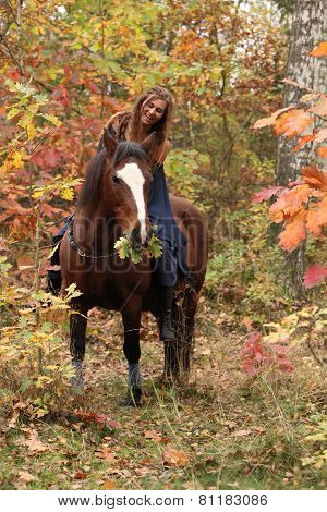 Nice Girl With Brown Horse In Autumn