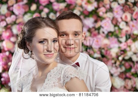 Happy Couple On The Flowers Wall Background