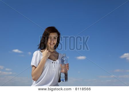 girl holding a bootle of water