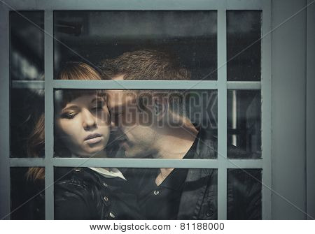Depressed Young Couple Standing Close To Each Other