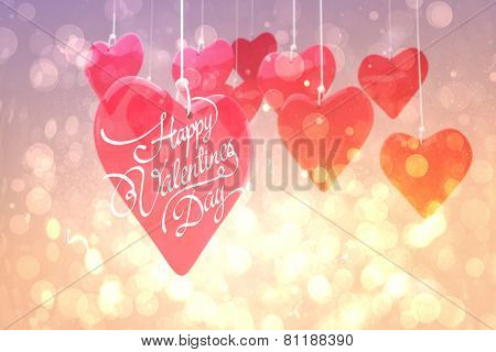 Happy valentines day against pink abstract light spot design