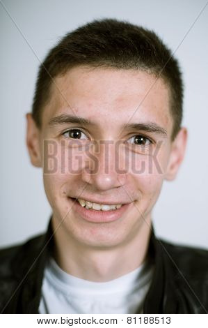 Artistic portrait of a real young smiling man