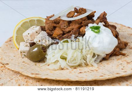 Gyros Pita With Tzatziki Coleslaw Olives And Feta Cheese
