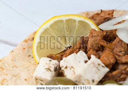 Gyros Pita With Tzatziki Coleslaw Olives And Feta Cheese