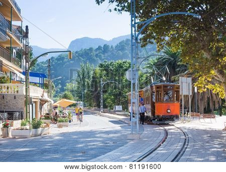 Street View In Port De Soller Mallorca With Tram And Bicyclist