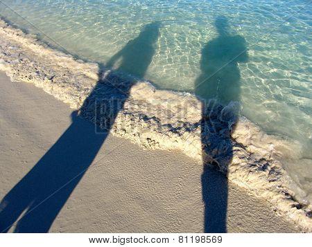 People Shadows On The Beach