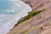 pic of early morning  - The Grand Sable Dunes seen here in the light of an early autumn morning steeply rise from the shore of Lake Superior near Grand Marais Michigan in Pictured Rocks National Lakeshore park - JPG