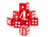 image of cheating  - some stacked red dice behind a 666 Cheating or reducing the odds  - JPG