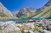 picture of crystal clear  - Mountain huts by crystal clear lake in mountain range Tien - JPG