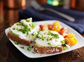 image of avocado  - poached eggs and avocado on toast with tomatoes - JPG
