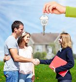 image of residential home  - Happy Family near new home - JPG