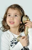 foto of babbler  - Cute young girl talking on the retro telephone - JPG