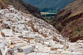 stock photo of salt mine  - Maras salt mines in the peruvian Andes at Cuzco Peru - JPG