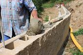 pic of bricklayer  - bricklayer builds a wall - JPG
