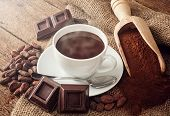 stock photo of cocoa beans  - Cup of hot chocolate with cocoa powder cocoa beans and pieces of chocolate - JPG