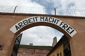 stock photo of nazi  - Archway with the Nazi motto Arbeit Macht Frei  - JPG