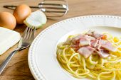 picture of carbonara  - spaghetti carbonara on wooden table with ingredient  - JPG