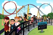 stock photo of exciting  - A vector illustration of excited children waiting in line for a roller coaster ride - JPG