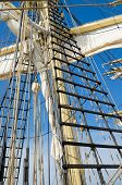 picture of sailing vessel  - Sails and tackles of a sailing vessel on a background of the sky