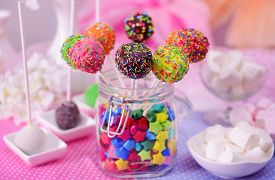foto of cake pop  - Sweet cake pops in jar on table on bright background - JPG