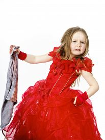foto of cinderella  - Young cinderella dressed in red preparing to mop the floor by dirty cloth - JPG