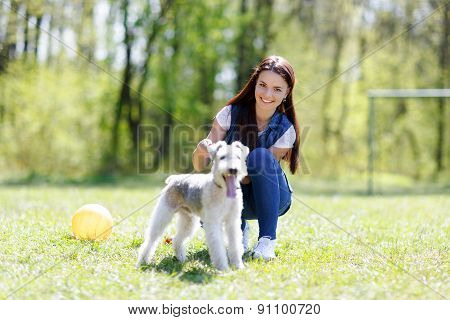 portrait of Beautiful young girl with her dog