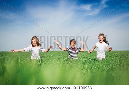 Little girls running on the field