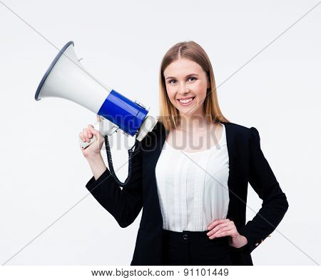 Happy businesswoman holding megaphone over gray background and looking at camera