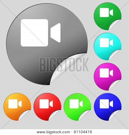 Video Camera  Icon Sign. Set Of Eight Multi-colored Round Buttons, Stickers. Vector