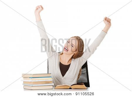Happy woman finished preparing to exam.
