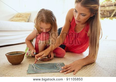 Mother And Little Daughter Together Drawing Pictures