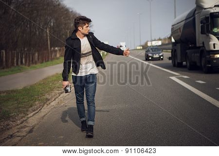 Hitchhiking travel man at the route